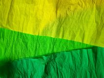 Yellow green paper background silk surface empty blank sheets vivid colors. Wrapping Royalty Free Stock Photography