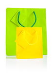 Yellow and green paper bags isolated Stock Photography