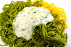 Yellow and green pasta with sauce Royalty Free Stock Image
