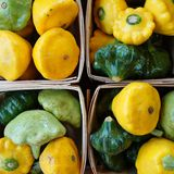 Yellow and green pattypan summer squash Stock Photo