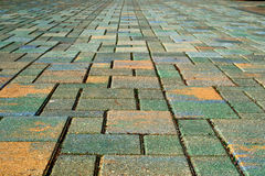 Yellow and green paving stones Royalty Free Stock Image