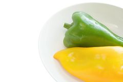 Yellow and green peppers Stock Images