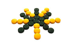 Yellow and green pills in the form of star Stock Photos