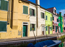 Yellow Green and Pink Homes in Burano Stock Photos
