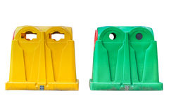 Yellow and green plastic garbage containers isolated on white background Royalty Free Stock Photo