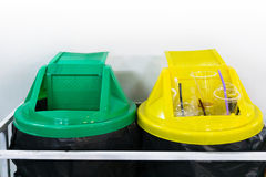 Yellow and green plastic trash recycle bin Stock Photography