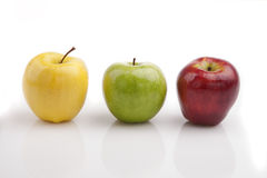 Yellow, green and red apples Stock Images