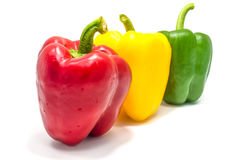 Yellow green and red bell peper on white background. Royalty Free Stock Photos