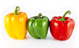 Yellow, Green  and Red Bell Peppers Stock Photos