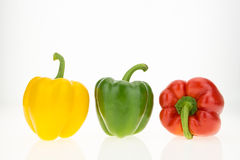 Yellow, green and red bell peppers Stock Photography