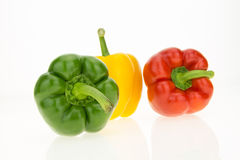 Yellow, green and red bell peppers Royalty Free Stock Images