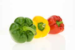 Yellow, green and red bell peppers Royalty Free Stock Image