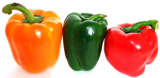 Yellow, green and red bell peppers. On white background Stock Photo