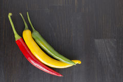 Yellow, green and red hot chili peppers Royalty Free Stock Photos