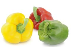 Yellow, green and red peppers isolated on white background. Yellow, green and red peppers isolated on white royalty free stock photo