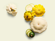 Yellow, green and round courgette on white background. Yellow, white and green zucchini, courgette and round pattipan squashes on white background. Sorts of Royalty Free Stock Images