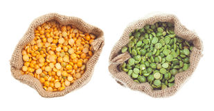 Yellow and green split pea. Canvas bags of dry yellow and green split peas Stock Photos