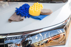 Yellow, green sponges and blue mitts for washing and microfiber fabric Royalty Free Stock Photo
