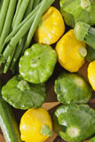 Yellow and green squashes with zucchini and green beans Stock Photos