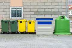 Yellow and green street garbage containers Royalty Free Stock Photos