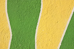 Yellow and green stucco background Stock Photography