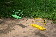 Yellow and green swing Stock Photo