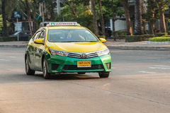 Yellow green taxi in bangkok stock images