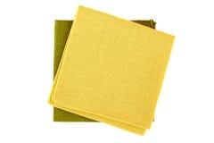Yellow and green textile napkins on white Stock Photos