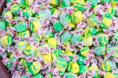 Yellow and Green Twist Wrapped Candy. With White and Red Wrappers stock images