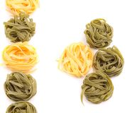 Yellow and green uncooked tagliatelle Royalty Free Stock Photography