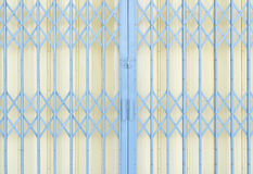 Yellow and grey metal grille sliding door Royalty Free Stock Photography