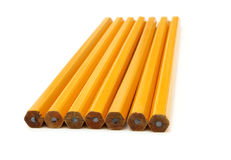 The yellow ground pencil. Lies is isolated on a snow-white background Stock Photography