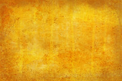 Yellow grunge background. Grunge style background with splatters and paint Stock Photo