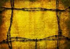 Yellow grunge barbed wire. Yellow grunge background framed with barbed wire royalty free stock image