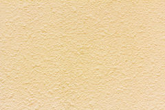 Yellow grunge cement wall, textured background Stock Photography