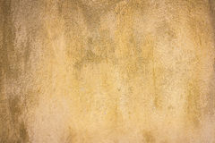 Yellow grunge cement wall, textured background Royalty Free Stock Image