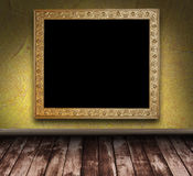 Yellow grunge room with picture frame Royalty Free Stock Photos