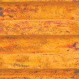 Yellow grunge sea freight container background, dark rusty corrugated pattern, red primer coating horizontal rusted detailed steel Royalty Free Stock Photo