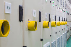 Yellow guard of switch control electrical equipment cabinet Royalty Free Stock Images