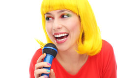 Yellow hair girl with microphone Royalty Free Stock Photos