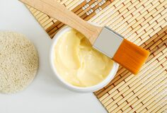 Free Yellow Hair Mask Banana Face Cream, Shea Butter Facial Mask, Body Butter In The Small White Jar. Natural Skin And Hair Concept. Stock Image - 173325291