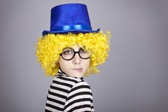 Yellow-haired girl in blue cap Stock Photos