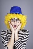 Yellow-haired girl in blue cap Royalty Free Stock Photo