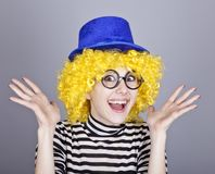 Yellow-haired girl in blue cap Stock Images