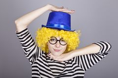 Yellow-haired girl in blue cap Royalty Free Stock Images