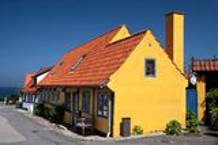 Yellow half-timbered house on Bornholm Stock Photo