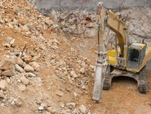Yellow hammer machine on construction site Stock Image