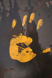 Yellow hand Stock Images