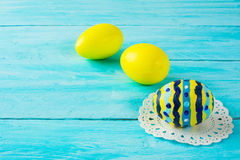 Yellow hand-painted Easter eggs Royalty Free Stock Images