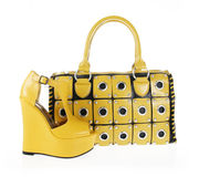 Yellow handbag and wedge shoe isolated on white Royalty Free Stock Photo